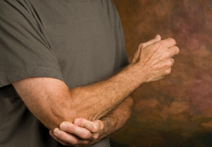 Image of chiropractic patient with tennis elbow pain.